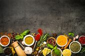 Set Of Various Spices And Herbs On Black Slate Background. Pepper, Turmelic, Ginger, Saffron, Basil, poster