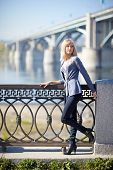 picture of novosibirsk  - Young woman in town Novosibirsk with the bridge and river on background - JPG