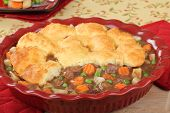 pic of biscuits gravy  - Beef pot pie with carrots potatoes; and peas