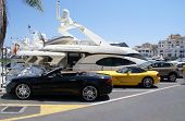 pic of luxury cars  - Luxury cars in the car park of the yacht club of Marbella Spain - JPG
