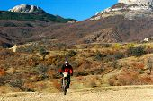 picture of moto-x  - shot of moto racer in mountains en route - JPG