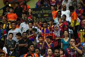 KUALA LUMPUR - AUGUST 10: Malaysian and FC Barcelona fans fill up the stadium for a friendly match a