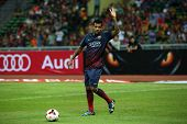 KUALA LUMPUR - AUGUST 10: FC Barcelona's player Dani Alves waves to fans warm-up before the match ag