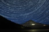 stock photo of perseus  - Star Trails Over Mount Hood at Trillium Lake Oregon with Perseid Meteors - JPG