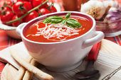 Thick tomato soup with noodles and basil