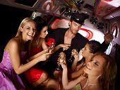stock photo of limousine  - Hot bachelorette party party in limousine with handsome chauffeur and beautiful girls - JPG
