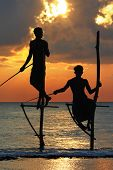 amazing sunset in Sri lanka with traditional stick-fishermen