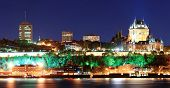 Постер, плакат: Quebec City skyline panorama at dusk over river viewed from Levis