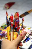foto of bute  - Art palette with a lot of paints and paintbrushes - JPG