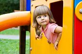 stock photo of playtime  - Happy Smiling Child   In Small House On Playground - JPG