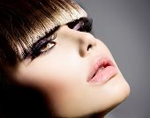 Fringe. Fashion Model Girl With Trendy Hairstyle and Makeup closeup. Haircut. Stylish Beauty Brunett