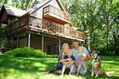 stock photo of log cabin  - a happy smiling family of four people - JPG