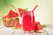 stock photo of tumbler  - Fresh water melon drink on wood - JPG
