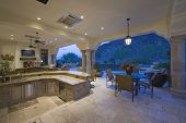 pic of hacienda  - Sitting area by sunken kitchen with view of porch at home - JPG