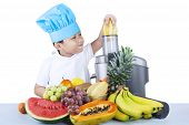 stock photo of juicer  - Portrait of cute asian boy is making fruit juice - JPG
