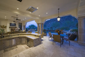 foto of screen-porch  - Sitting area by sunken kitchen with view of porch at home - JPG