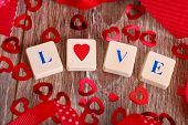 picture of scrabble  - love word made of scrabble letters and heart shape for valentine on wooden table - JPG