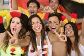 stock photo of enthusiastic  - Group of enthusiastic German sport soccer fans celebrating victory - JPG