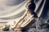 foto of ballet shoes  - Little girl trying on ballet shoes - JPG
