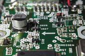 pic of capacitor  - Macro of a Circuit Board With Chips and Capacitor - JPG