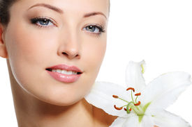 picture of beautiful woman face  - Fresh clear healthy skin on the face of beautiful woman over white background - JPG