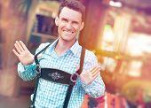 stock photo of lederhosen  - Young man posing in traditional Bavarian Lederhosen - JPG