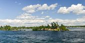 picture of windswept  - House on a windswept island of the Thousand Islands on the Saint Lawrence River - JPG
