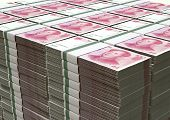 stock photo of yuan  - A pile of stacked wads of chinese yuan banknotes on an isolated background - JPG