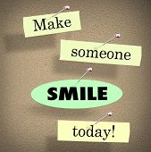 foto of bulletin board  - Make Someone Smile Today words on papers in a saying or quote pinned to a bulletin board - JPG