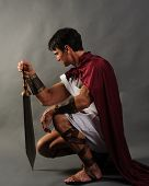 stock photo of battle  - a roman warrior sits and waits for battle - JPG