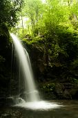 foto of grotto  - A waterfall in a forest - JPG