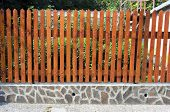 foto of old stone fence  - fence of wooden slats on the stones - JPG