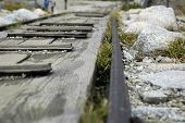 stock photo of railcar  - close up view of rails in mountains - JPG
