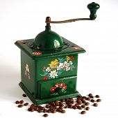stock photo of wooden box from coffee mill  - Ancient manual coffee grinder and coffee beans - JPG