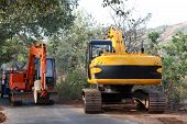 stock photo of dozer  - Dozers working at a road construction site in India - JPG