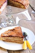 foto of crepes  - Chocolate crepe cake with cream and jam - JPG