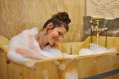 picture of bubble-bath  - young pretty woman taking a bubble bath - JPG