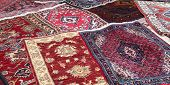 picture of iranian  - sale of fine Oriental rugs hand knotted in an antique shop - JPG