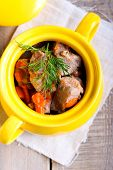 image of stew pot  - Meat and carrot stew in a pot - JPG