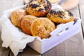 stock photo of bagel  - Homemade bagels with with black and white sesame in tray - JPG