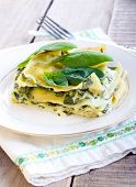 stock photo of lasagna  - Creamy spinach and cheese lasagna on plate - JPG