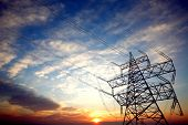 pic of power transmission lines  - Pylon and power lines at sunset with nice sky and sun - JPG
