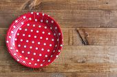 pic of gizmo  - Spanish dishes with red polka dots on wooden table - JPG