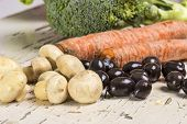 foto of olive shaped  - Mixed vegetable on a vintage table - JPG