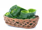 pic of pasilla chili  - sliced poblano pepper on bamboo basket on white background - JPG
