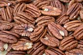 stock photo of pecan  - a group of pecan halves on flat for background uses - JPG