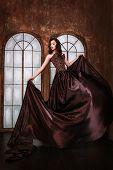 image of fascinating  - Portrait of  beautiful woman in brown dress - JPG