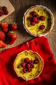 stock photo of berries  - Lemon tart with rosemary and berries filled with cream topped berries - JPG