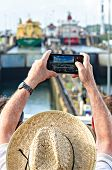 image of shoot out  - Tourists shoot a photograph at the entrance of the ships in the Panama Canal - JPG