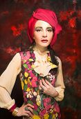 picture of turban  - Portrait of young woman in pink turban and in vintage dress - JPG